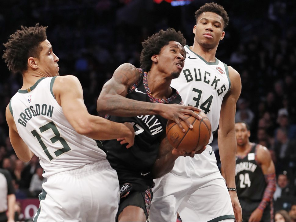 (AP Photo/Kathy Willens) Ed Davis, with the Brooklyn Nets, has agreed to join the Utah Jazz in a free agent deal announced Sunday, June 30, 2019. In this photo, Milwaukee Bucks guard Malcolm Brogdon (13) and Bucks forward Giannis Antetokounmpo (34) double-team Davis (17) who gets sandwiched driving to the basket during the first half of an NBA basketball game, Monday, Feb. 4, 2019, in New York.