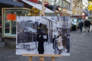 In this Tuesday, Nov. 6, 2018 photo a Nov. 10, 1938 photo from the AP Archive, showing by Nazis destroyed Jewish shops at the Kurfuerstendamm street, is placed at the same location 80 years later in Berlin, Germany.  On Nov. 9, 1938 Jews and their holdings were attacked across Nazi Germany - also known as Kristallnacht or Night of the broken glasses. (AP Photo/Markus Schreiber)