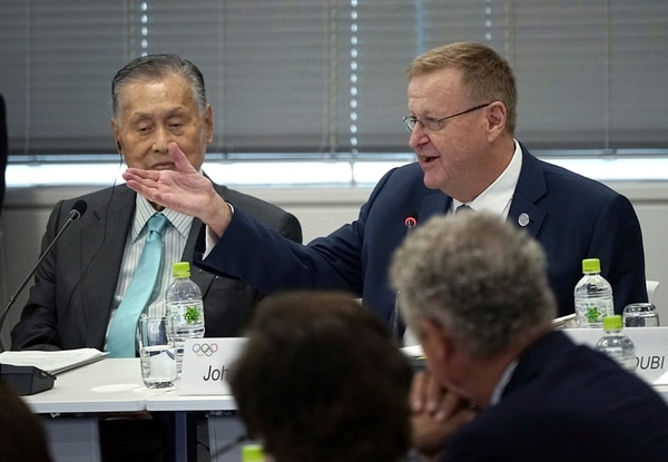 International Olympic Committee (IOC) Vice President John Coates, right top, delivers opening remarks as he is flanked by Tokyo 2020 Olympics President Yoshiro Mori, left top, during the IOC Coordination Commission opening plenary for the Olympic Games Tokyo 2020 in Tokyo Wednesday, June 28, 2017. (AP Photo/Eugene Hoshiko)