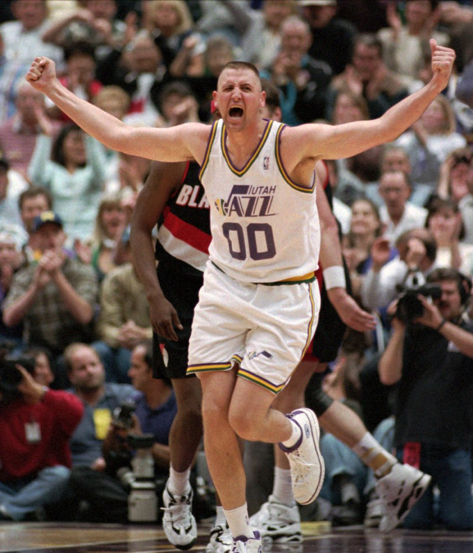 Utah Jazz center Greg Ostertag celebrates his slam dunk against the Portland Trail Blazers in the third period Saturday, April 27, 1996, in Salt Lake City. The Jazz beat the Blazers 105-90 to take a 2-0 lead in the playoffs. (AP Photo/Steve Wilson)