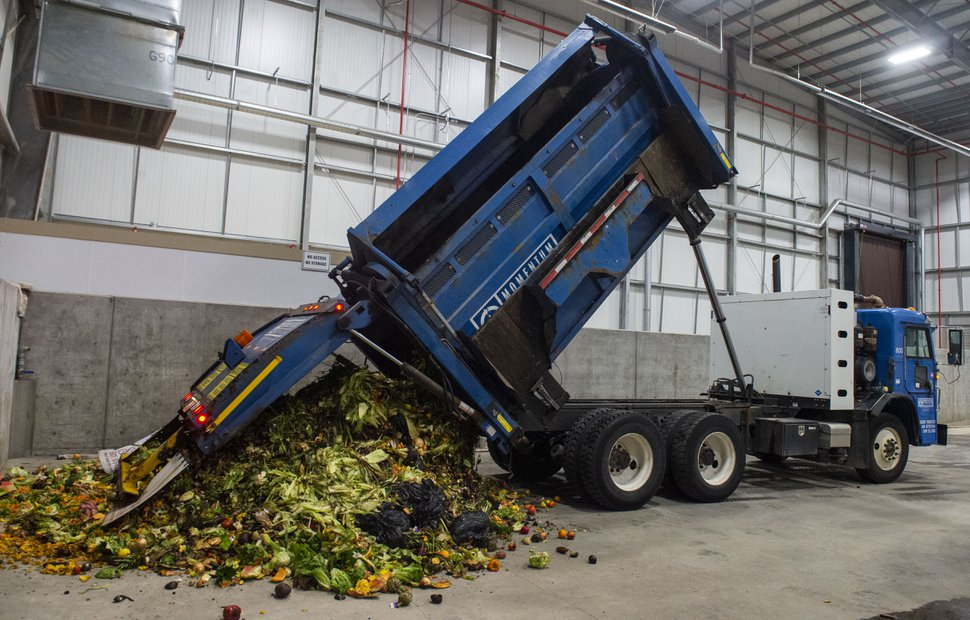 (Rick Egan | The Salt Lake Tribune) A truck from Momentum recycling dumps a load of food waste at Wasatch Resource Recovery in North Salt Lake on Friday, May 24, 2019.