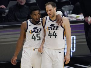 Utah Jazz guard Donovan Mitchell, left, puts his arm around forward Bojan Bogdanovic in the closing minutes of the second half in Game 6 of a second-round NBA basketball playoff series Friday, June 18, 2021, in Los Angeles. (AP Photo/Mark J. Terrill)