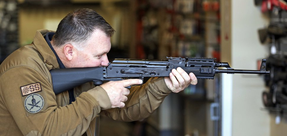 (Rick Bowmer | The Associated Press) Clark Aposhian, chairman of the Utah Shooting Sports Council, demonstrates how a bump stock works when attached to a semi-automatic rifle at the Gun Vault store and shooting range Wednesday, Oct. 4, 2017, in South Jordan, Utah.