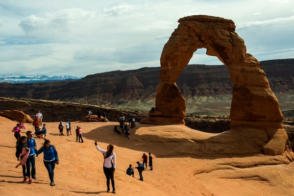 Chris Detrick | The Salt Lake Tribune Visitors take pictures and hike around Delicate Arch in Arches National Park Saturday March 5, 2016.