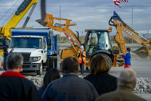 (Leah Hogsten  |  The Salt Lake Tribune) Salt Lake City Mayor Jackie Biskupski celebrates after exiting a front end loader after dumping its bucket of concrete during a ground breaking for the new construction of a Water Reclamation Facility, the largest non-airport public works facility in Salt Lake City history, Oct. 22, 2019. The $528-million wastewater treatment project will take six years to complete.