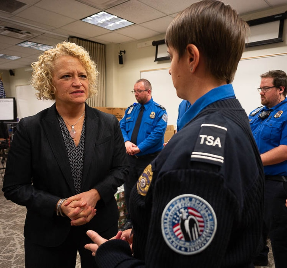 (Trent Nelson | The Salt Lake Tribune) Salt Lake City Mayor Jackie Biskupski speaks to TSA employee Woodrina Berg. Biskupski had pizza delivered to TSA and other federal employees to thank them for working at the airport without pay during the partial federal shutdown on Tuesday Jan. 22, 2019. Food from the Utah Food Pantry was stacked around the training room to cover the needs of employees.