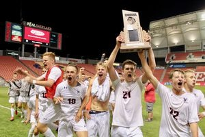 (Christopher Kamrani | The Salt Lake Tribune) Alta's Joshua Affleck holds the Class 5A trophy above his head after the Hawks defeated Viewmont 2-1 in extra time of the 5A state championship match Thursday, May 24, 2018, at Rio Tinto Stadium in Sandy.