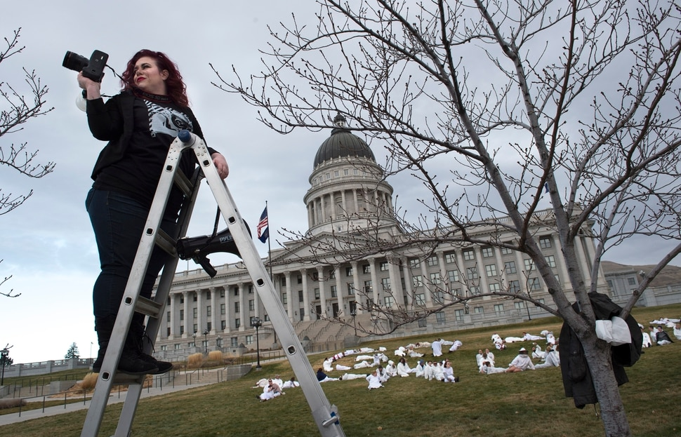 (Scott Sommerdorf | The Salt Lake Tribune) Artist Cat Palmer makes photos of protesters dressed in white jumpsuits who spelled out GO HOME TRUMP on the south lawn of the Utah State Capitol, Sunday, December 3, 2017, during a protest organized by artist Cat Palmer ahead of Trump's visit Monday. When asked why she organized the event she said: Because Senator Dabakis called me and told me too! We don't have somebody representing our voices right now, right? Thats a problem. Sometimes when we feel helpless we make art hoping our voices will be heard. It's an outlet for people. It's therapeutic, .... because we are feeling lost right now.