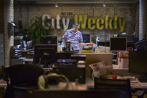 (Leah Hogsten | Tribune file photo) City Weekly owner and publisher John Saltas is photographed in 2020 in the publication's newsroom. A former editor of the paper says City Weekly owes him thousands in unpaid wages.