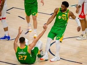 (Trent Nelson     The Salt Lake Tribune) Utah Jazz center Rudy Gobert (27), Utah Jazz guard Donovan Mitchell (45)  as the Utah Jazz host the Houston Rockets, NBA basketball in Salt Lake City on Friday, March 12, 2021.