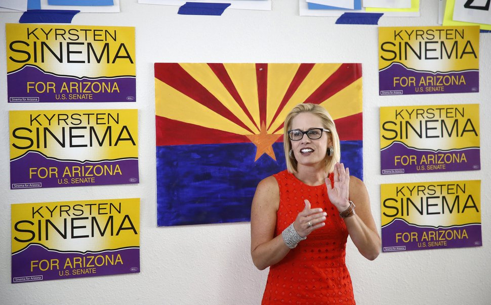 (AP Photo/Ross D. Franklin) Rep. Kyrsten Sinema, D-Ariz., talks to campaign volunteers at a Democratic campaign office on primary election day Tuesday, Aug. 28, 2018, in Phoenix. Sinema is seeking the current U.S. Senate seat occupied by outgoing Republican Sen. Jeff Flake, and will face the Republican primary winner of the race between Rep. Martha McSally, former state Sen. Kelli Ward, and former Maricopa County Sheriff Joe Arpaio, if Sinema wins the Democratic primary.