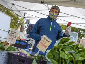 """(Leah Hogsten     The Salt Lake Tribune) Randy Hed with Blue Spring Farm pitches his produce on the final day of the Salt Lake City Farmer's Market, Oct. 24, 2020. Hed and his wife Tamara are farmers from Bothwell who sell vegetables and greens every year at the market """"There's been less people, but the people here are motivated to buy,"""" said Tamara of the crowd on the last day."""