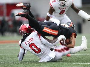 Utah linebacker Devin Lloyd (0) brings down Oregon State wide receiver Trevon Bradford (8) during the first half of an NCAA college football game Saturday, Oct. 23, 2021, in Corvallis, Ore. (AP Photo/Amanda Loman)