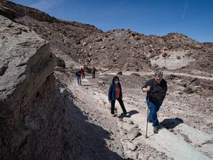 (Francisco Kjolseth  | The Salt Lake Tribune) State Sen. Jani Iwamoto, center, and Utah Paleontologist Jim Kirkland tour the site of the new Utahraptor State Park. Iwamoto was the co-sponsor of the legislation creating the park, which contains the largest array of dinosaur species on the planet. It is also the site of a World War II Japanese isolation camp that will be memorialized within the park.