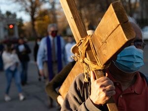 (Francisco Kjolseth  | The Salt Lake Tribune) Utah Christians walk the streets of Salt Lake City beginning at Cathedral of the Madeleine on Good Friday, to symbolically mark Jesus' carrying the cross to his crucifixion, April 2, 2021.