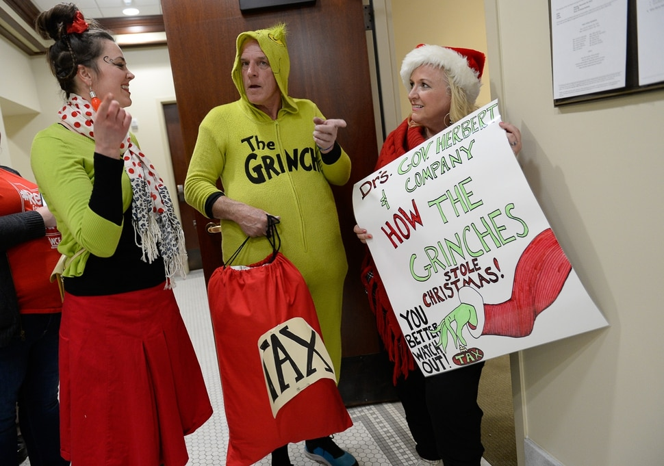(Francisco Kjolseth | The Salt Lake Tribune) Jonalee Tobias, Greg Zenger and Stephanie Clancy, from left, depict The Grinch as they attend the tax reform task force meeting at the Utah Capitol on Monday, Nov. 25, 2019.