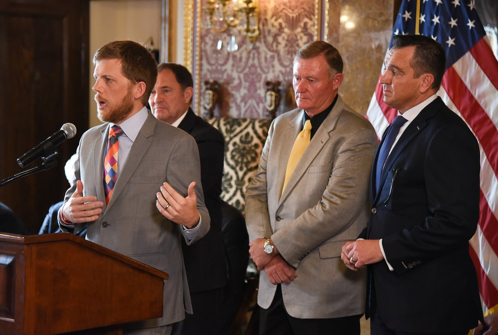 (Francisco Kjolseth | The Salt Lake Tribune) Libertas Institute president Connor Boyack answers questions from the media alongside Gov. Gary Herbert, Sen. Evan Vickers, R-Cedar City, and House Speaker Greg Hughes, from left, following an announcement of a compromise to the medical marijuana bill. Supporters and opponents of UtahÕs medical marijuana initiative joined with Utah Gov. Gary Herbert and legislative leaders Thursday, Oct. 4, 2018, at the Utah Capitol to announce a Òshared visionÓ for cannabis policy.