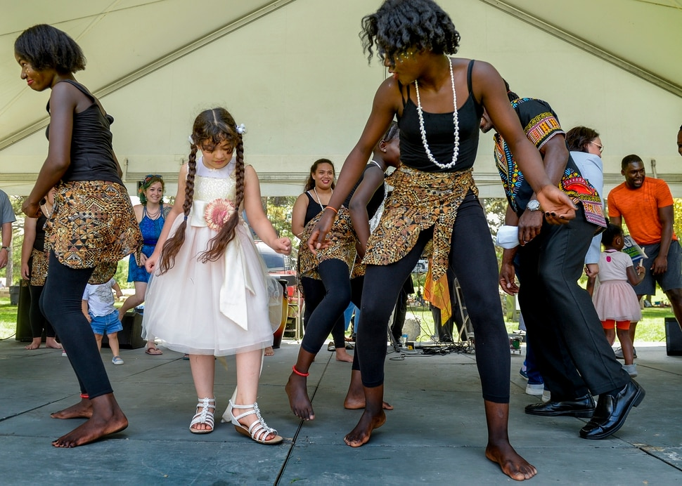 (Leah Hogsten | The Salt Lake Tribune) Fatimah Ali learns African dancing from Ornella Ddjoh during the 4th Annual African Festival sponsored by the United Africans of Utah, Saturday, July 27, 2019 at Liberty Park. The African Festival promotes African tradition, culture and heritage through the arts, food fashion, music and dance.
