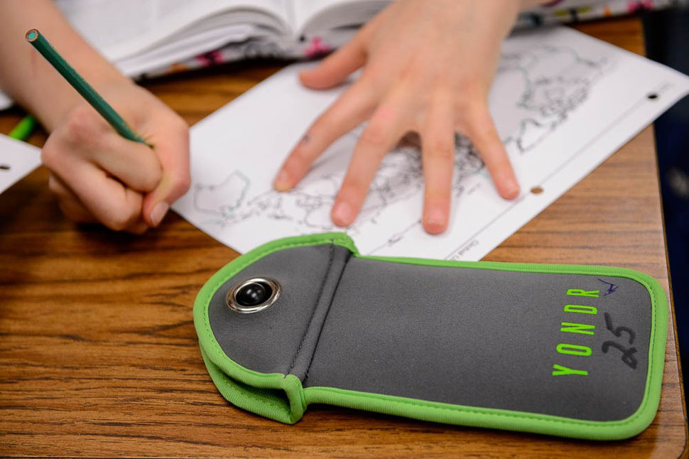 (Trent Nelson | The Salt Lake Tribune) Students in Monta Thomas' classes at Brighton High School in Cottonwood Heights secure their phones in locking pouches made by the company Yondr.
