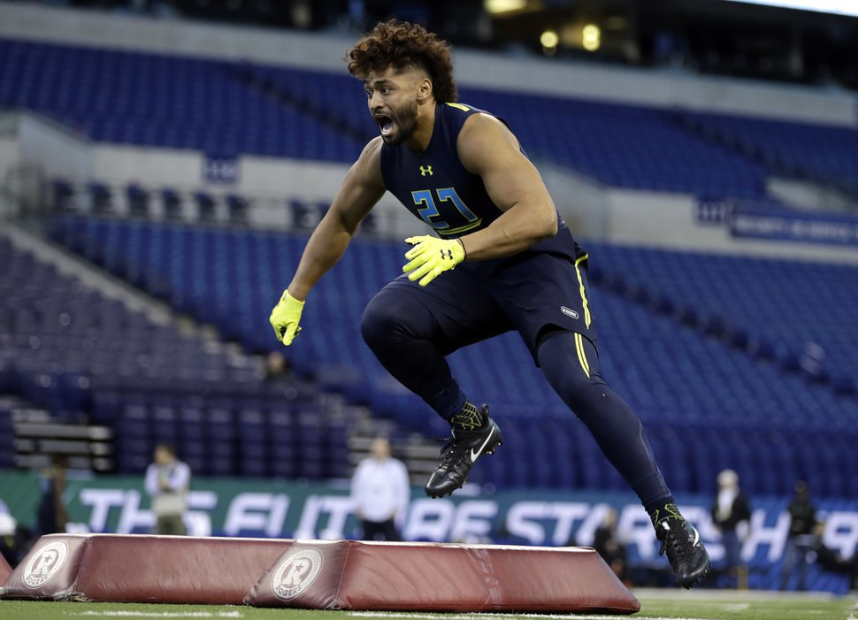 BYU defensive end Harvey Langi runs a drill at the NFL football scouting combine Sunday, March 5, 2017, in Indianapolis. (AP Photo/David J. Phillip)