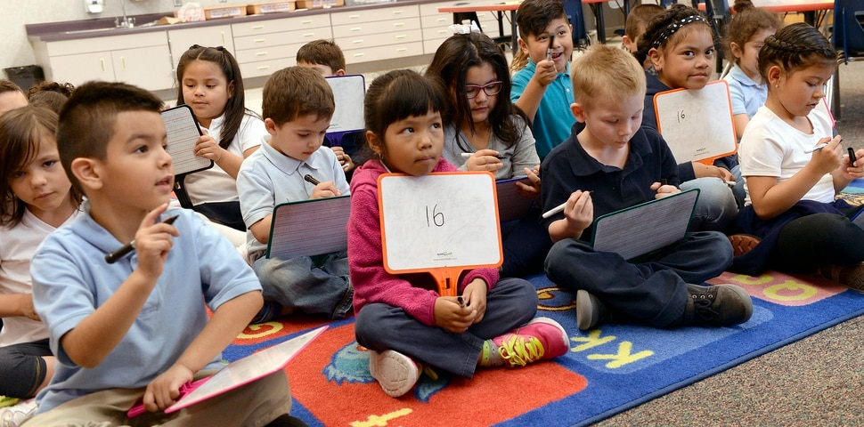 (Al Hartmann | The Salt Lake Tribune) Kindergarten students work out math addition problems on their tablets in Denise White's class at Riley Elementary School in Salt Lake City Tuesday April 10, 2018. Utah's average scores on the Nation's Report Card for 2017 have improved from two years ago, but state officials remain concerned that minority and low-income students in the state continue to lag behind their peers.