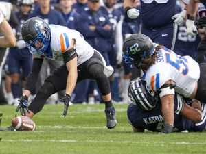 (Leah Hogsten | The Salt Lake Tribune) Boise State Broncos safety Alexander Teubner (34) picks up a fumble from Brigham Young Cougars running back Lopini Katoa (4) right, after he was tackled by Boise State Broncos linebacker DJ Schramm (52) as No. 10 Brigham Young University hosts Boise State at LaVell Edwards Stadium, Oct. 9, 2021.
