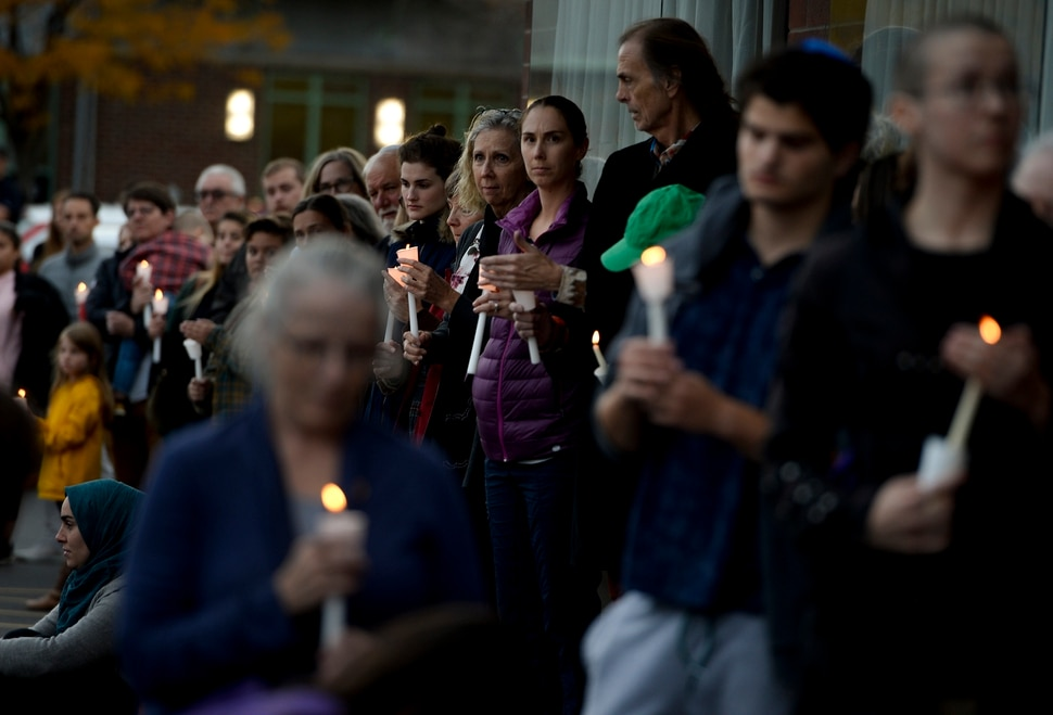 Leah Hogsten | The Salt Lake Tribune Candles are lit outside Chabad Lubavitch of Utah as members of Utah's Jewish and interfaith communities held a vigil and prayer service, Monday, Oct. 29, 2018 for the 11 people killed at the Tree of Life Synagogue in Pittsburgh, Monday, Oct. 29, 2018, for peace, harmony and love to once again reign supreme upon this Earth.