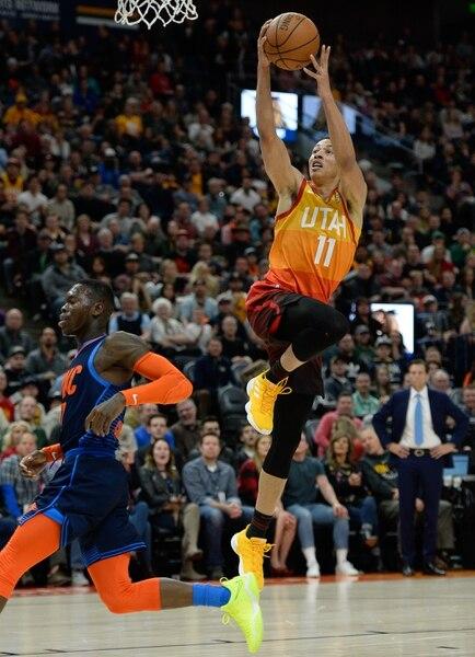 (Francisco Kjolseth | The Salt Lake Tribune) Utah Jazz guard Dante Exum (11) lays one up past the Thunder in the NBA game at Vivint Smart Home Arena Sat., Dec. 22, 2018, in Salt Lake City.