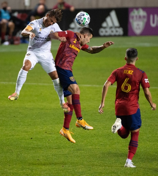 (Francisco Kjolseth | The Salt Lake Tribune) Los Angeles Galaxy midfielder Jonathan dos Santos (8) battles Real Salt Lake defender Aaron Herrera (22) as Real Salt Lake hosts L.A. Galaxy at Rio Tinto Stadium in Sandy on Wednesday, Sept. 23, 2020.