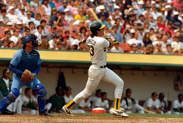 (Bill Beattie | AP file photo) Jose Canseco, shown hitting his 40th homer of the season on Sept. 18, 1988, in Oakland, will be participating in a fundraising home run derby for Utah's Herriman High School on Saturday, June 2, 2018.