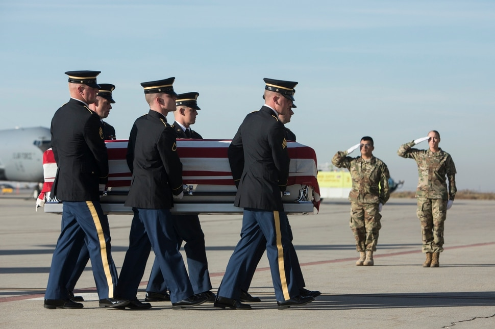 (Matt Herp | The Ogden Standrad Examiner/Pool) Utah National Guard Honor Guard Detail members carry a casket containing the remains of Maj. Brent R. Taylor at Roland R. Wright Air National Guard Base in Salt Lake City, Utah, on Wednesday, Nov. 14, 2018. Taylor, 39, of North Ogden, died Nov. 3, 2018, in Afghanistan of wounds sustained from small arms fire. His funeral is scheduled for Saturday, Nov. 17, in Ogden.