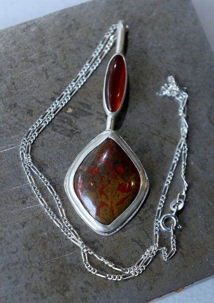 (Al Hartmann | The Salt Lake Tribune) Silver pendant with red jasper stone, a work by Asia Dutson for Craft Lake City.