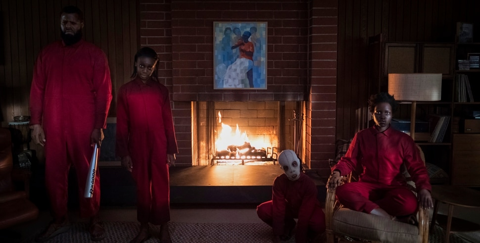 This image released by Universal Pictures shows Winston Duke, Shahadi Wright Joseph, Evan Alex and Lupita Nyong'o in a scene from Us, written, produced and directed by Jordan Peele. (Claudette Barius/Universal Pictures via AP)