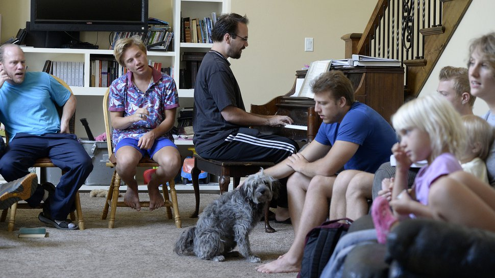 (Al Hartmann | The Salt Lake Tribune) Members of Denver Snuffer's Remnant movement meet in a Sandy home Sunday, Aug. 13, to sing songs and take sacrament. Many in the movement believe that the LDS Church has strayed from its origins and reject the present structure and authority.