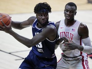 (John Locher | AP) Utah State's Neemias Queta drives into UNLV's Cheikh Mbacke Diong during the first half of an NCAA college basketball game against Utah State, Wednesday, Jan. 27, 2021, in Las Vegas.