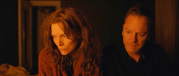 This image released by the Sundance Institute shows Michelle Pfeiffer, left, and Kiefer Sutherland in
