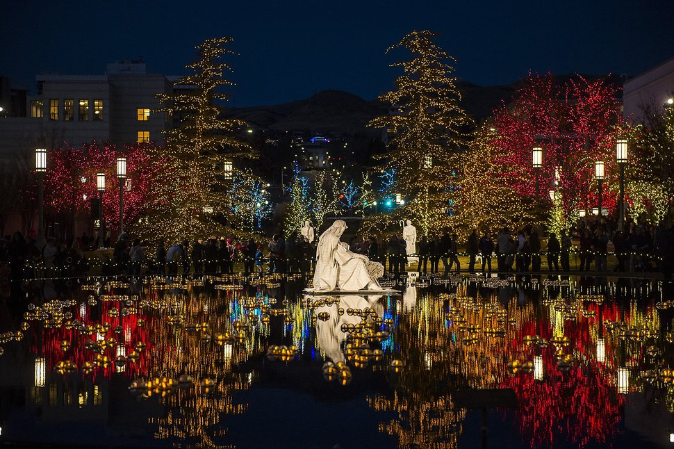 (Chris Detrick | The Salt Lake Tribune) Visitors look at Christmas Lights on Temple Square Friday, November 24, 2017. The first year the light were put up on Temple Square was in 1965. The lights will run through the end of the year.