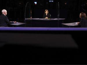 (Justin Sullivan   Pool via AP) Vice President Mike Pence listens as Democratic vice presidential candidate Sen. Kamala Harris, D-Calif., speaks during the vice presidential debate Wednesday, Oct. 7, 2020, at Kingsbury Hall on the campus of the University of Utah in Salt Lake City.