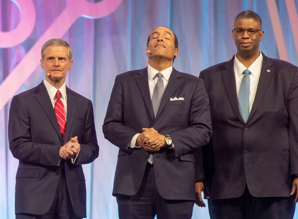 (Rick Egan | The Salt Lake Tribune) Michael Boulware Moore, president of the International African American Museum, in Charleston South Carolina,reacts as LDS apostle David A. Bednar, announces the LDS church's $2 million donation to the IAAM museum, at the RootsTech convention at the Salt Palace Convention Center. Thom Reed, Deputy Chef Genealogical Officer for Family Search International is on the right. Wednesday, Feb. 27, 2019.