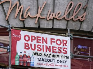 "(AP file photo) An ""Open For Business"" sign on front Maxwell's East Coast Eatery in Salt Lake City, as seen in September. Utah's unemployment rate fell back to 4.1% in October, according to the Labor Department, compared to 6.9% for the U.S. as a whole."