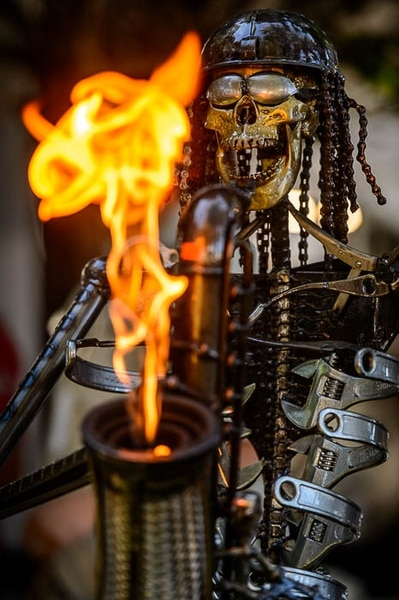 (Trent Nelson | The Salt Lake Tribune) A skeletal saxophone-playing sculpture by Fred Conlon gets flaming hot at the Utah Arts Festival in Salt Lake City, Thursday June 21, 2018.