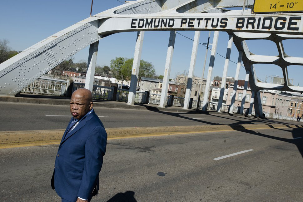 Congressman John Lewis stands on the Edmund Pettus Bridge on Sunday, March 4, 2018, in Selma, Ala., during the annual commemoration of