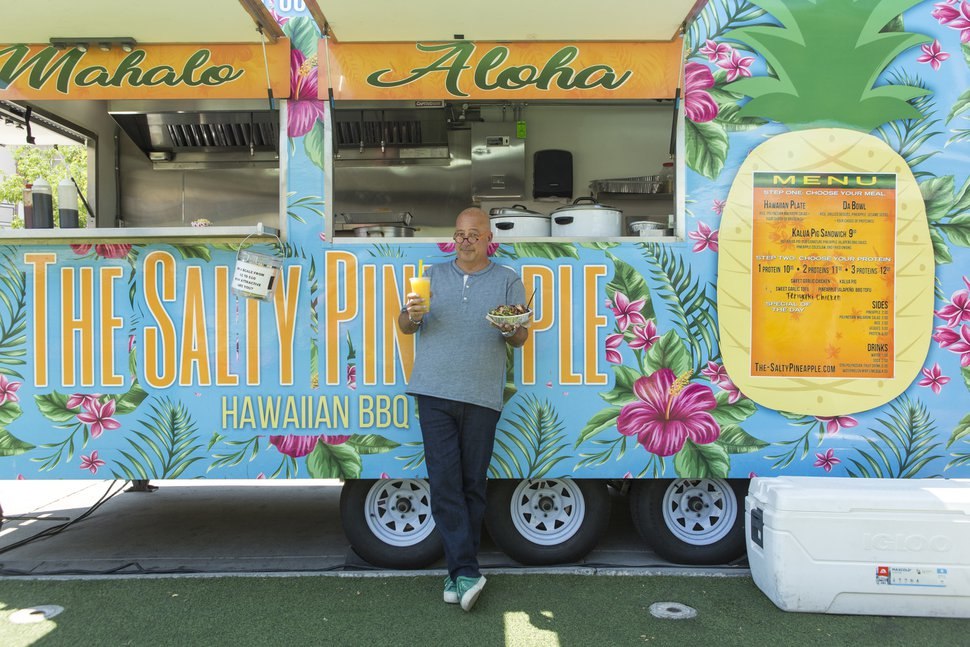 (Photo courtesy of Food Network) Host Andrew Zimmern pauses at Salt Lake City's Salty Pineapple food truck during the filming of