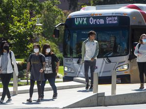 (Rick Egan | Tribune file photo) Pedestrians wearing face masks during the pandemic exit a UTA bus in downtown Provo on Sept. 11, 2020.