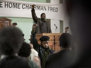 "(Glen Wilson  |  courtesy Warner Bros. Pictures) Daniel Kaluuya, top, plays Black Panther Party leader Fred Hampton, while LaKeith Stanfield (in front of the podium) plays his friend-turned-informant, William O'Neal, in director Shaka King's political drama ""Judas and the Black Messiah."" The film has been added to the Premieres program of the 2021 Sundance Film Festival."