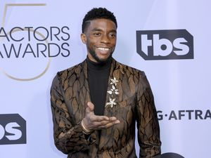 (Willy Sanjuan  |  Associated Press file photo) In this Jan. 27, 2019 file photo, Chadwick Boseman arrives at the 25th annual Screen Actors Guild Awards at the Shrine Auditorium & Expo Hall in Los Angeles.  Boseman, who played Black icons Jackie Robinson and James Brown before finding fame as the regal Black Panther in the Marvel cinematic universe, has died of cancer. His representative says Boseman died Friday, Aug. 28, 2020 in Los Angeles after a four-year battle with colon cancer. He was 43.