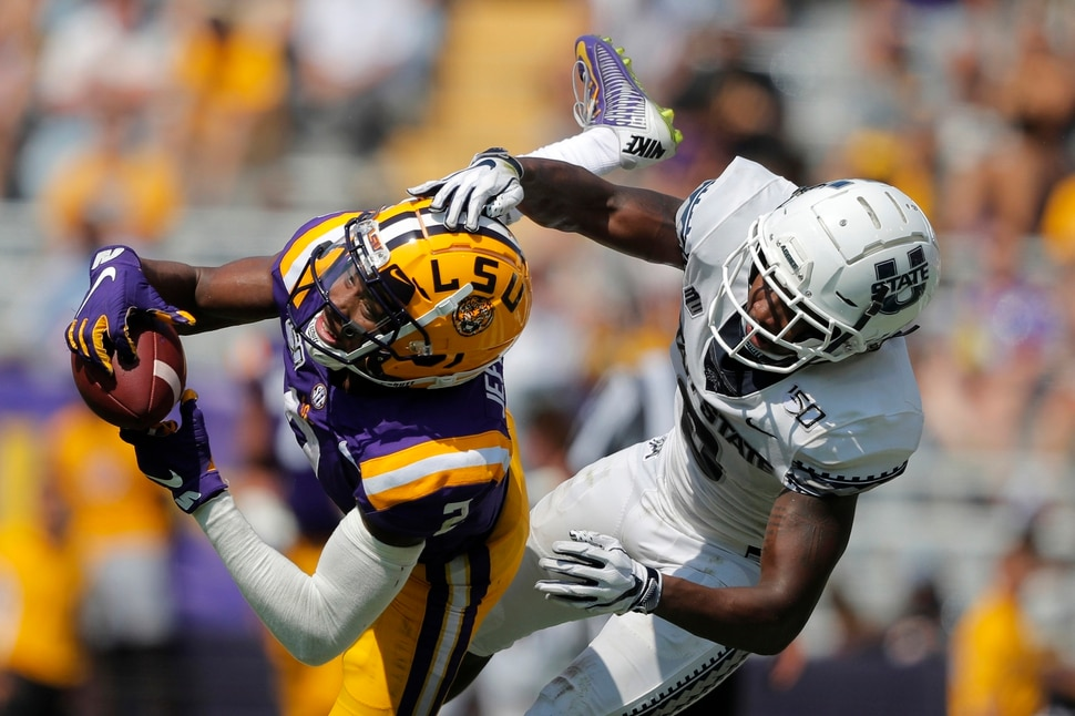 LSU wide receiver Justin Jefferson (2) pulls in a pass against Utah State cornerback Cameron Haney in the first half of an NCAA college football game in Baton Rouge, La., Saturday, Oct. 5, 2019. (AP Photo/Gerald Herbert)