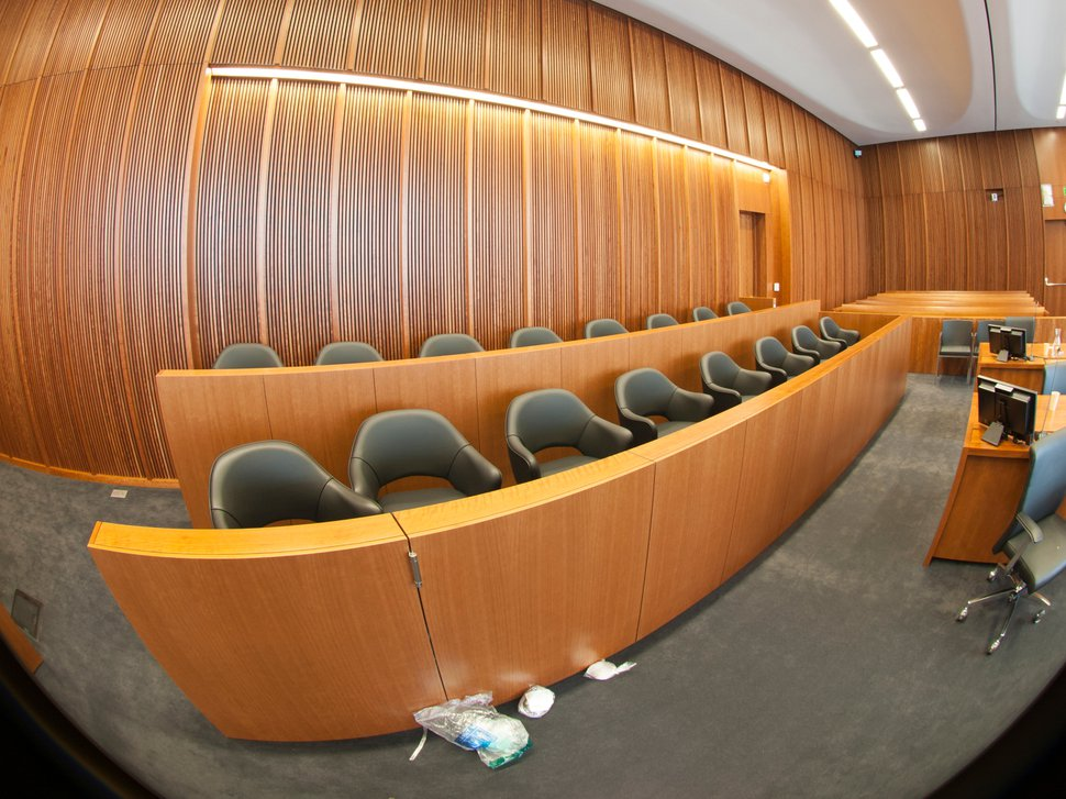 (Photo courtesy of FBI via Freedom of Information Act) This 2014 photo shows the jury box in the new federal courthouse in Salt Lake City Siale Angilau, 25, ran past before a marshal shot him to death. The photo was taken after the shooting by a device which creates a 360-degree image. Leftover bandages appear to be on the floor.