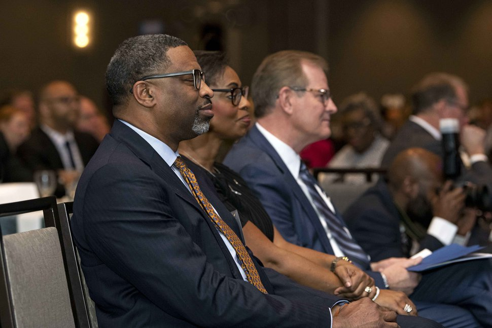 (Photo courtesy of The Church of Jesus Christ of Latter-day Saints) NAACP President Derrick Johnson and Vice Chairwoman Karen Boykin-Towns with apostle Gary E. Stevenson at event in Arlington, Va.