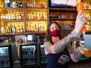 (Francisco Kjolseth  | The Salt Lake Tribune) Robin Brown pours drinks at the Green Pig Pub in Salt Lake City during the slow lunch hour on Thursday, Dec. 3, 2020.